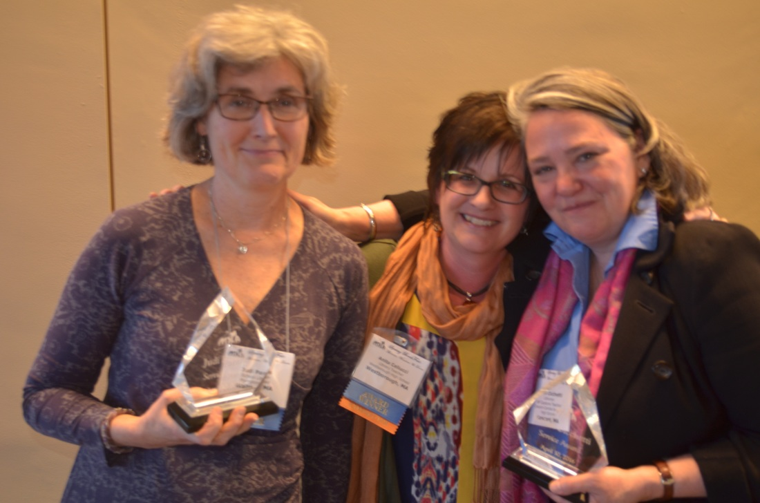 Judi Paradis (left) and Robin Cicchetti (right) received the 2016 Service Award, pictured here with MSLA president Anita Cellucci. Missing from photo, Carol Gordon.