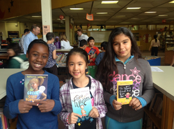 students happily holding books