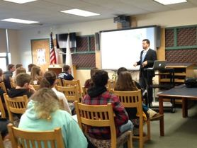 Author giving a presentation to a group of students
