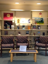 The Nook Nook features comfortable chairs and books.